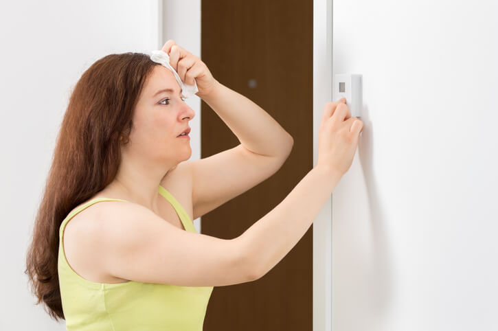 Woman Troubleshooting AC
